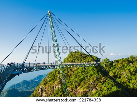 Photo of the Sky bridge symbol Langkawi island. Adventure holiday. Modern construction. Tourist attraction. Travel concept. #521784358