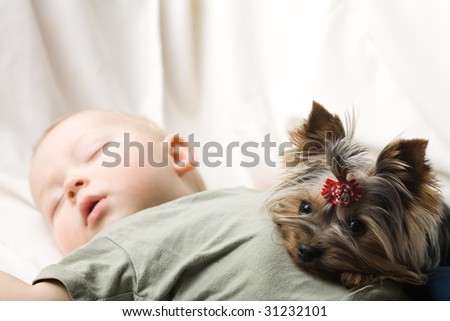 Photo of the sleeping baby with a terrier