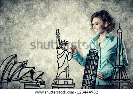 Photo of the smiling girl drawing different sights