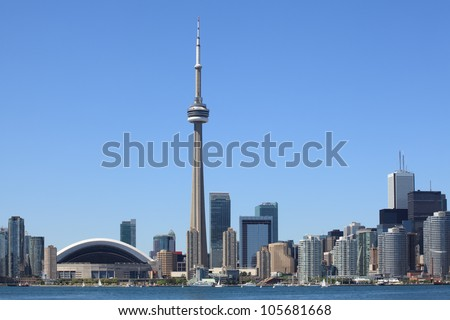 Photo of the Toronto skyline under a clear sky.