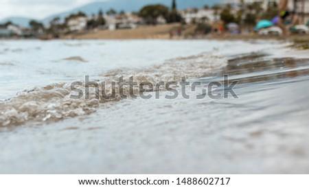 Photo of the water with the beach in the background in the Ebro Delta. San Carlos de La Rápita. Tarragona. Barcelona. Cataluña. San Carlos de La Rápita. #1488602717