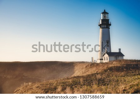 Photo of the yaquina Head Lighthouse at the Sunset time