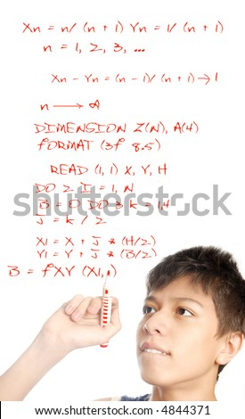 Photo of the young boy solving the mathematical problem