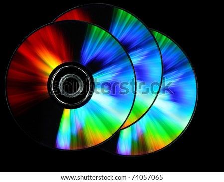 photo of three dvd on black background