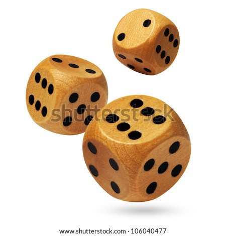 Photo of three wooden dices being rolled head on in a game of chance and isolated against a white background.