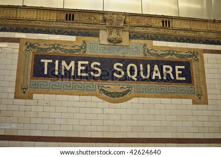photo of tiimes square sign on entrance to subway