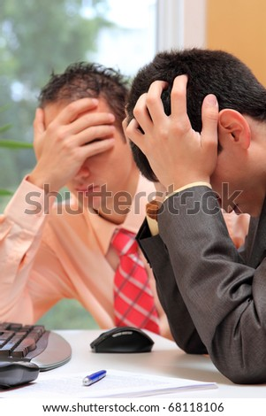 Photo of two business people worried
