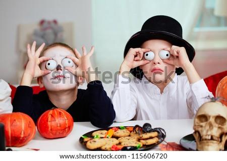 Photo of two eerie boys frightening people on Halloween - stock photo
