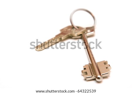 Photo of two keys lying on a white background