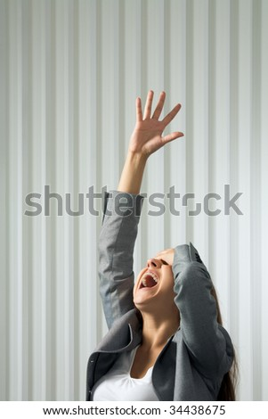 Photo of unhappy female shouting with her arm raised in pray