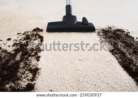 Photo Of Vacuum Cleaner Cleaning Dirt On Carpet