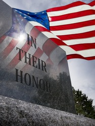 Photo of Veteran's Day or Memorial Day With United States Flag flying overhead and reflected in granite monument.