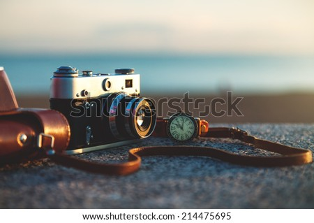 Photo of vintage camera at sunset in park #214475695