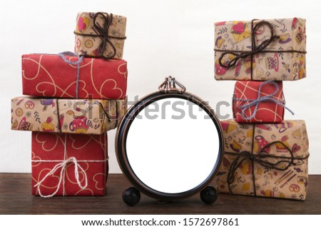 photo of vintage watches on the background of boxes with gifts; watch dial: empty space,  copy space ; symbol of the advent of Christmas and the new year; copy space
