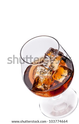 photo of whiskey cognac with ice cubes on white background
