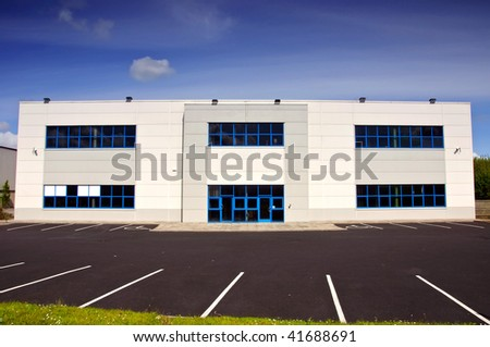 photo of white corporate office block for rent