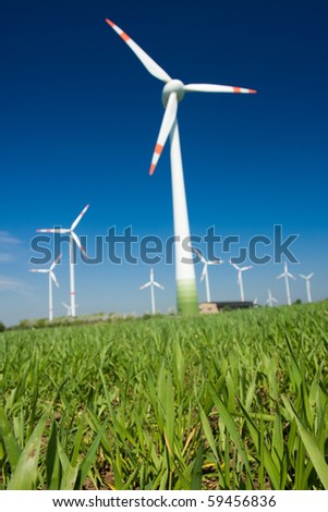 Photo of Wind power installation in sunny day