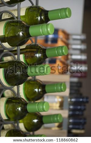 photo of wine bottles on a wine rack
