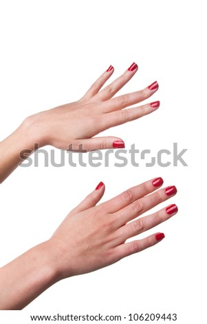 Photo of woman hands with red nails isolated on white