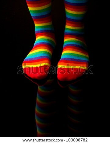 photo of woman leg with colorful socks