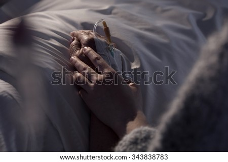 Photo of woman supporting dying mother with cancer Stock foto ©