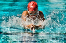 Photo of Woman Swimming in a swimming pool