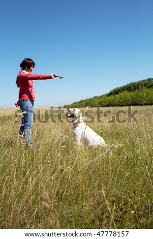Photo of woman training her dog