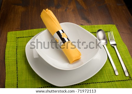 photo of wood table with dishes which is ready to be seated for lunch