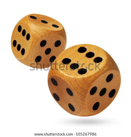 Photo of wooden dices being rolled head on in a game of chance and isolated against a white background.