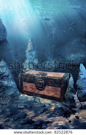 photo of wooden treasure chest submerged underwater with light rays