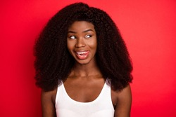 Photo of young attractive african girl happy positive smile lick teeth yummy look empty space isolated over red color background