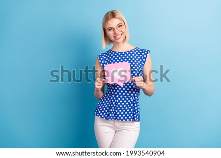 Photo of young attractive girl happy positive smile hold reaction icon popular like isolated over blue color background