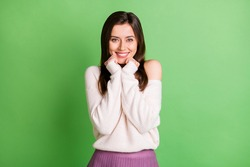 Photo of young attractive pretty smiling cheerful positive girl adoring admiring isolated on green color background