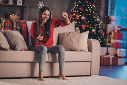 Photo of young beautiful attractive crazy excited smiling positive woman sit sofa play win videogame shout yeah at home house