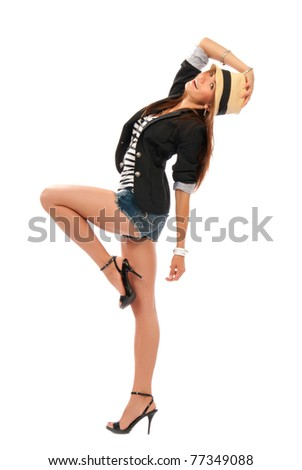 Photo of young beautiful brunette woman dancing in casual cloth and modern stylish hat isolated on a white background