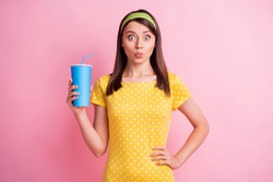 Photo of young beautiful shocked amazed surprised girl pout lips hold cola soda isolated on pink color background