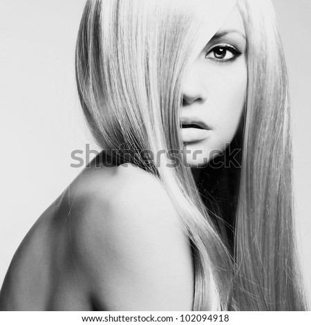 Photo of young beautiful woman with magnificent hair - stock photo
