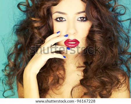Photo of young beautiful woman with red lipstick
