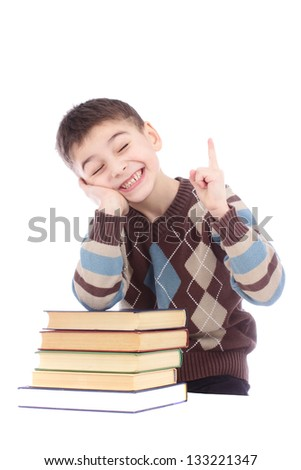 Photo of young boy with books showing finger up isolated over white background