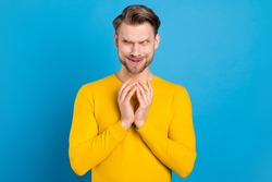 Photo of young brown hair man tricky cunning have idea look empty space isolated over blue color background