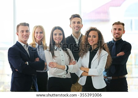 Photo of young business people in a conference room