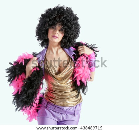 Photo of young cheerful woman in a black wig on a white background #438489715