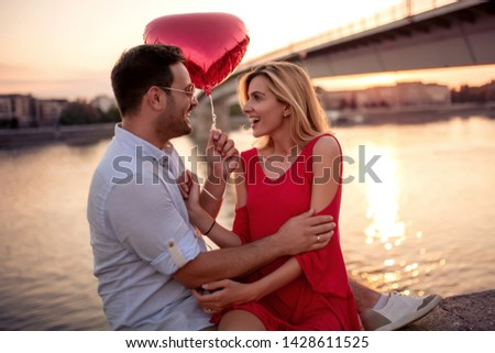 Photo of young couple enjoying in sunset. #1428611525