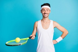 Photo of young excited sportive man excited happy smile hold tennis racket ball isolated over blue color background