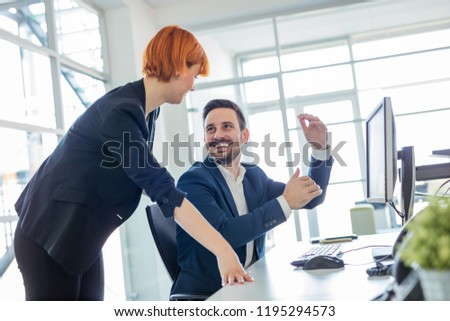 Photo of young freelance designers working in office #1195294573