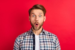 Photo of young handsome man amazed shocked surprised news sale excited isolated over red color background