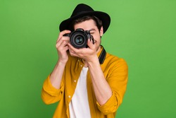 Photo of young handsome professional photographer take picture you camera isolated on green color background
