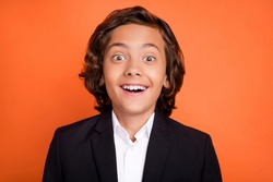 Photo of young happy positive amazed small boy shocked face wear formalwear isolated on orange color background