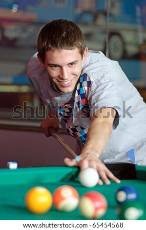 Photo of young man during snooker game.