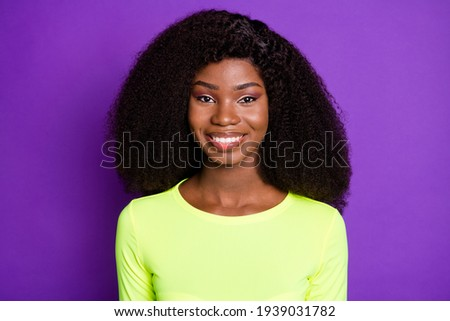 Photo of young pretty lovely good mood smiling afro girl with curtly hair in sportive suit isolated on purple color background Imagine de stoc ©